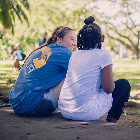 Student talks with a local girl during a mission trip.