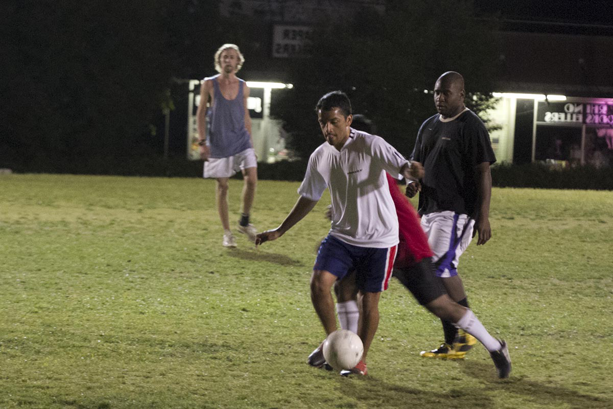 students play intramural soccer