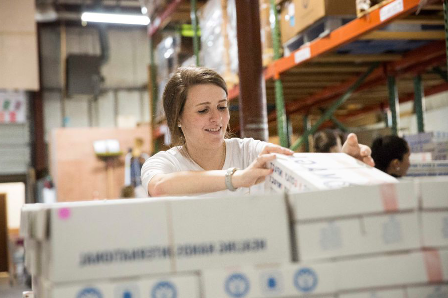 Student volunteering at a food warehouse