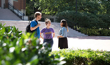 group of students talking outside