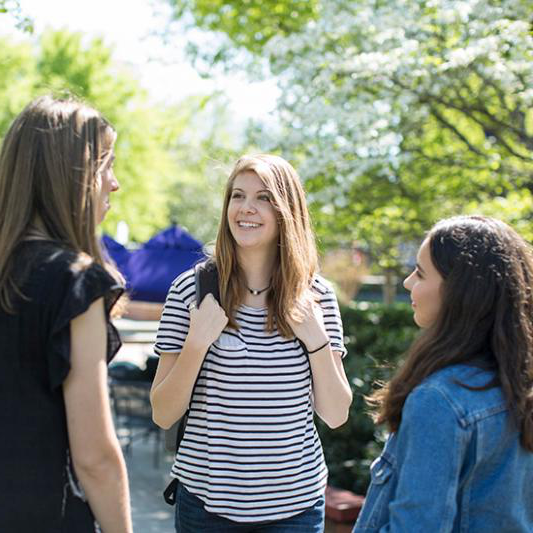 Three female students talking together outside at Lipscomb